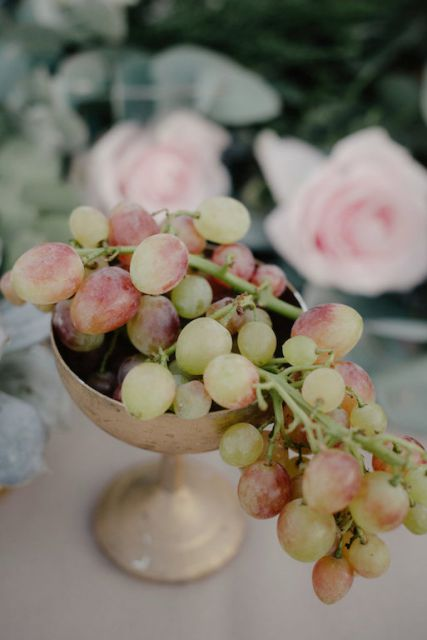 grapes fruit in vintage cup for centerpiece