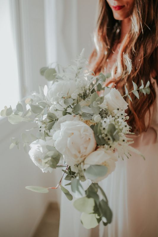 Bridal bouquet with white peonies and eucalyptus