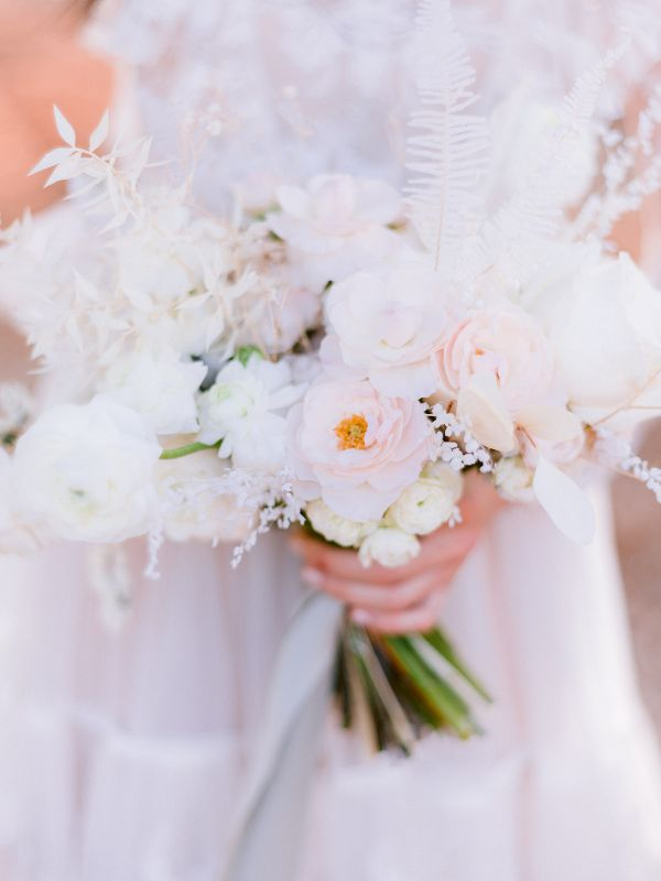 Ethereal bridal bouquet with white flowers and bleached fern