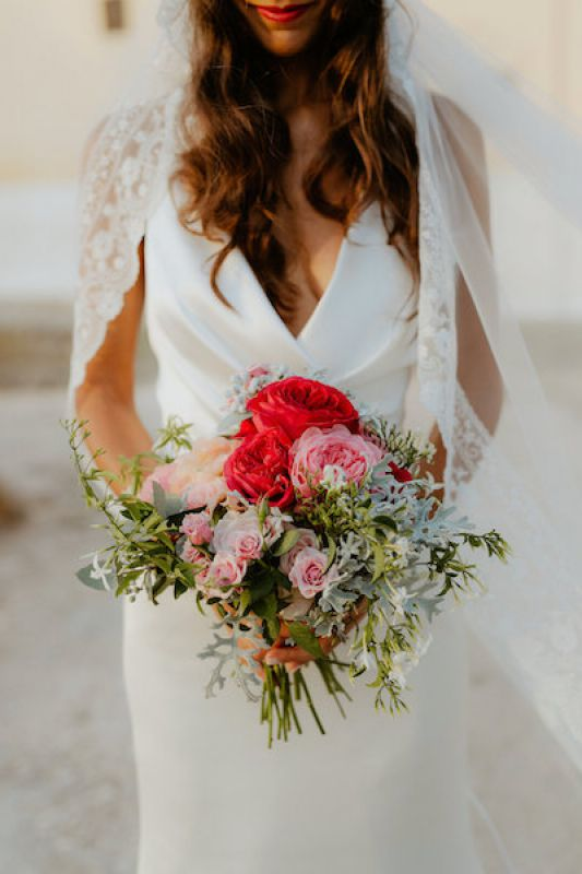 bohemian bridal bouquet with red and pink flowers