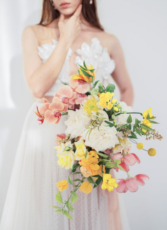 Colorful bridal bouquet. Spring flowers in pink, orange, yellow.