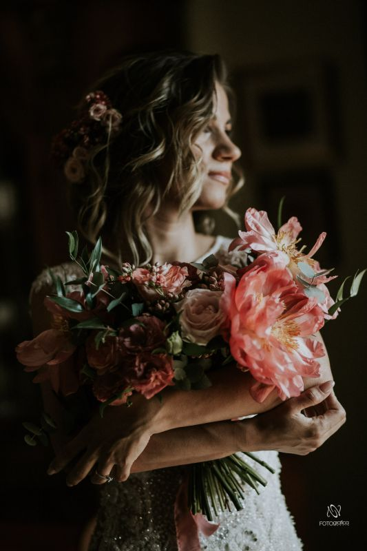 big bridal bouquet made with coral peonies