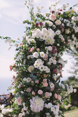 beautiful flower arch with dahalias and garden roses