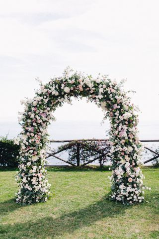 wild arch of flowers, white and pink color palette