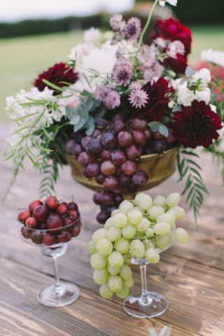 centerpiece for autumn wedding with flowers and fruit