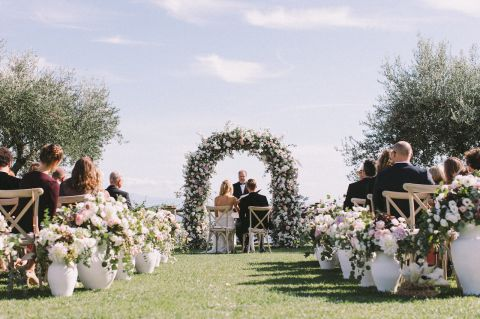 floral decor for aisle of open air wedding ceremony