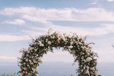 Romantic flower arch for wedding ceremony