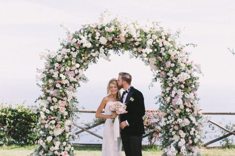 romantic flower arch made by an Italian floral designer