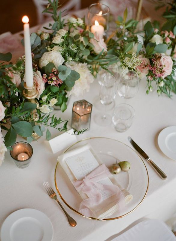 Romantic and natural centerpiece with mercury votives, napkins tied with silk ribbons and small golden pears as placecard