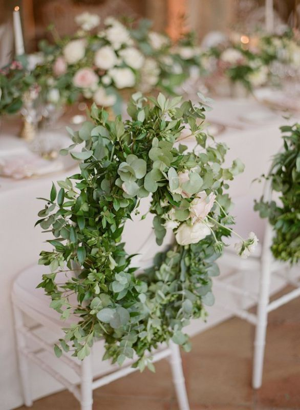Decoration for the bride and groom chairs made with eucalyptus garland