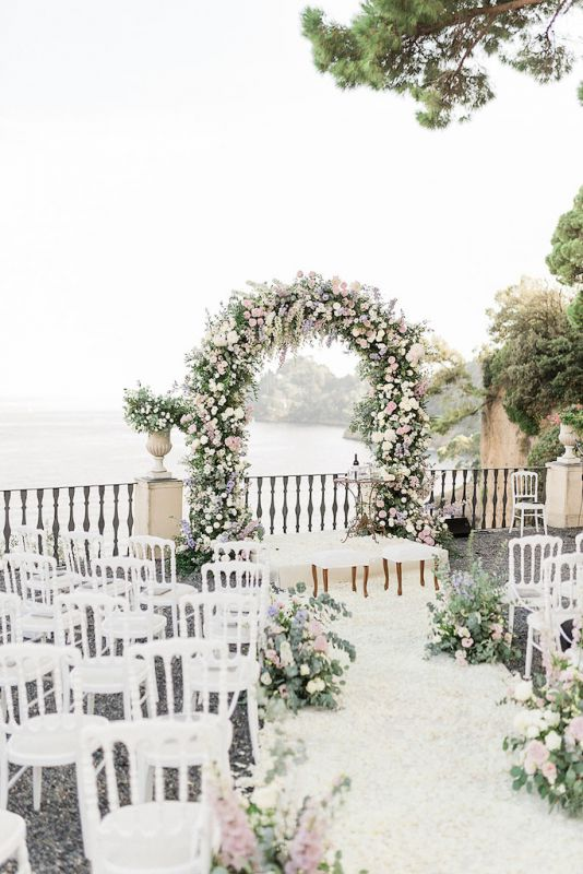 Ceremony on the terrace with romantic flower arch