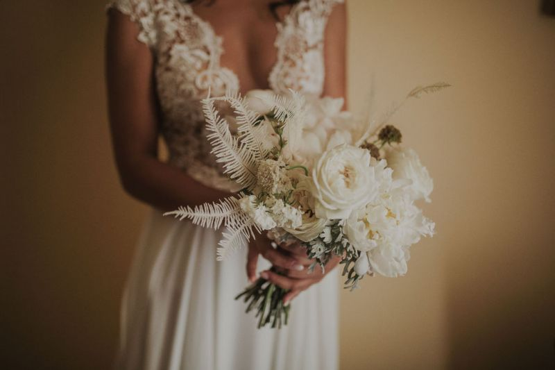 Bridal bouquet with peonies and bleached fern