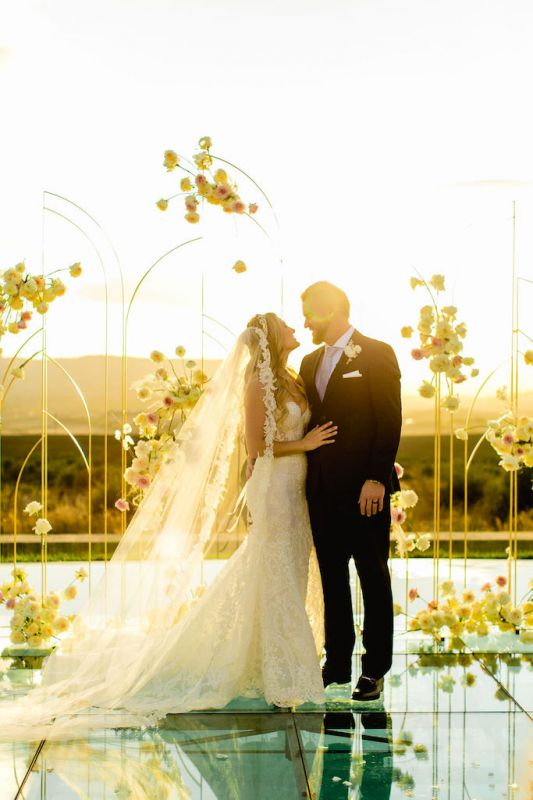 Ceremony backdrop in modern style with gold building and white flowers