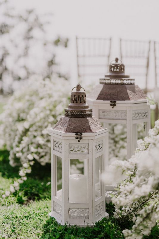 lanterns and flowers for the aisle