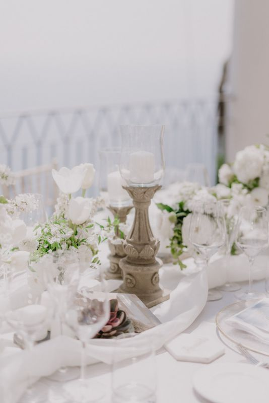 Wedding centerpiece in grey, gold and white palette