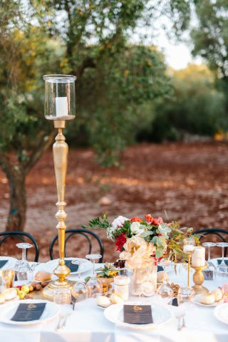 gold hig chandelier and rustic flowers for wedding