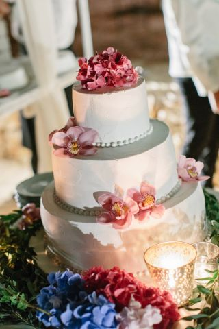 wedding cake with fresh flowers and candles