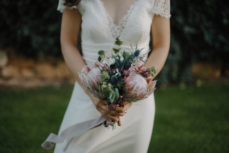 Bouquet for the bride with protea and thistle flowers