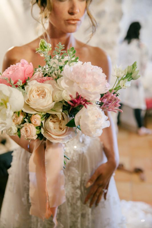 Bridalbouquet with seasonal flowers available in may:peonies and garden roses