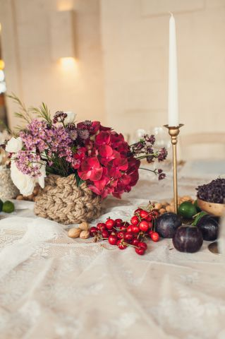 natural centerpiece with red fruit, cherry