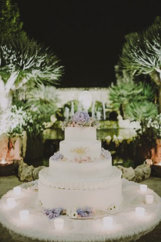 wedding cake with dusty blue flowers