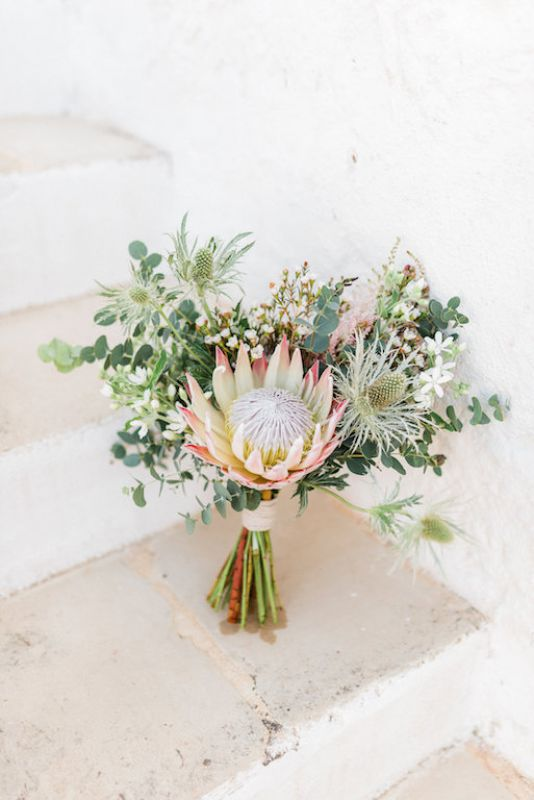 Boho chic bridal bouquet with protea and eringhium